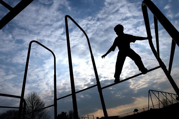 Chris Ammann/Examiner Josh Schimming, 11, of Jarrettsville plays on the playground equipment at North Harford Elementary School on Wednesday, March 29, 2006 in Pylesville.