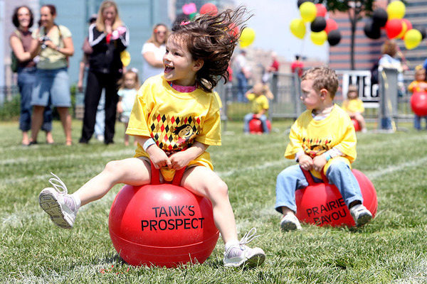Chris Ammann/Baltimore Examiner Alaina Dagenais, 3, left, bounces on her 'hippity-hop' during a race of the Pee Wee Preakness at Federal Hill Park on Tuesday, May 16, 2006.