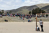 Onlookers at football posts watch a gathering of protesters at De Doorns