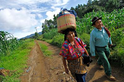 Farmers walk along gravel roads in Guatemala.  Photo by Kyle Spradley   www.kspradleyphoto.com