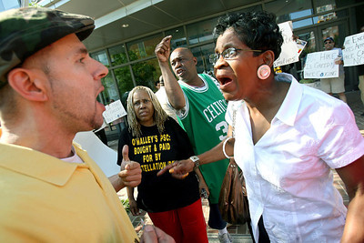 """A rally in front of Constellation Energy in Baltimore gets emotional as Ollie Davis, right, argues with Steven Ceci, left, and other activists of the """"Coalition to Stop the BGE Rate Hike,"""" on Thursday, May 24, 2007. Chris Ammann/Examiner"""