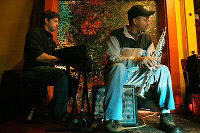 Chris Ammann/Baltimore Examiner Jazz musicians Harry Connick, Jr., left, and Branford Marsalis surprised the audience at the Cafe Brasil in New Orleans, La., with a performance on Monday, Jan. 8, 2007.