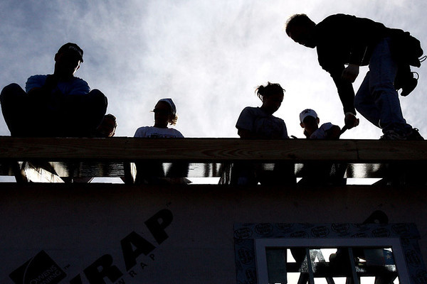 Chris Ammann/Baltimore Examiner University of Maryland marching band members and other volunteers work on the roof while working for Habitat for Humanity at the Musicians' Village in New Orleans, La., on Monday, Jan. 8, 2007.
