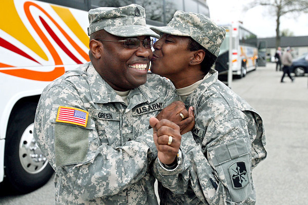Nathaniel Green, left, receives a kiss from his wife Beatrice before both are deployed for Iraq with the 58th Infantry Brigade Combat Team of the Maryland National Guard on Thursday, April 26, 2007 in Pikesville. Chris Ammann/Examiner