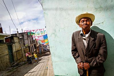 A man on a street corner in Santo Domingo Xenacoj, Guatemala.  Photo by Kyle Spradley | www.kspradleyphoto.com