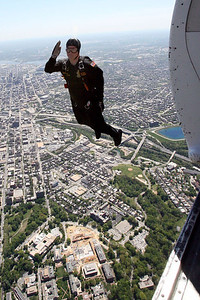 """Chris Ammann/Baltimore Examiner CPL Derrick Coleman of The United States Army Parachute Team the """"Golden Knights,"""" salutes after jumping from an airplane to land at Johns Hopkins University to deliver the gameball to the lacrosse team on Saturday, April 29, 2006."""