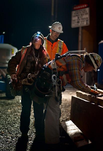 PMLR workers install two girders on the MAX Kellogg Lake Bridge along McLoughlin Blvd. in downtown Milwaukie Wednesday 11/20/13. The work continues all week, 2 girders per night, 14 girders in all.  © 2013 TriMet / Fred Joe / www.fredjoephoto.com