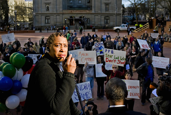 Reverend Reneé Ward talks through a bullhorn microphone to Portlanders upset by the police shooting of Aaron Campbell at Pioneer Courthouse Square Friday 2/19/10. Afterward they marched up Broadway to Portland State University where they held a rally. Oregon Attorney General John Kroger, who was at PSU for a meeting, spoke to the crowd.  © 2010 Fred Joe Photo