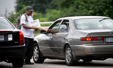 Mr. Bias, a homeless person on the streets of Arlington, Va., panhandles on the side of the road, 19 June 2013.    (Photo by Bernardo Fuller)