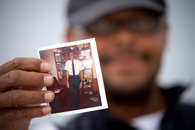 Mr. Bias, a homeless person on the streets of Arlington, Va., holds up a photo of himself as a young Airman when he was in the Air Force, 19 June 2013.  (Photo by Bernardo Fuller)