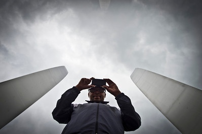 Mr. Bias, a homeless person on the streets of Arlington, Va., takes a photo of the photographer at the center of the Air Force Memorial, 19 June 2013.  (Photo by Bernardo Fuller)