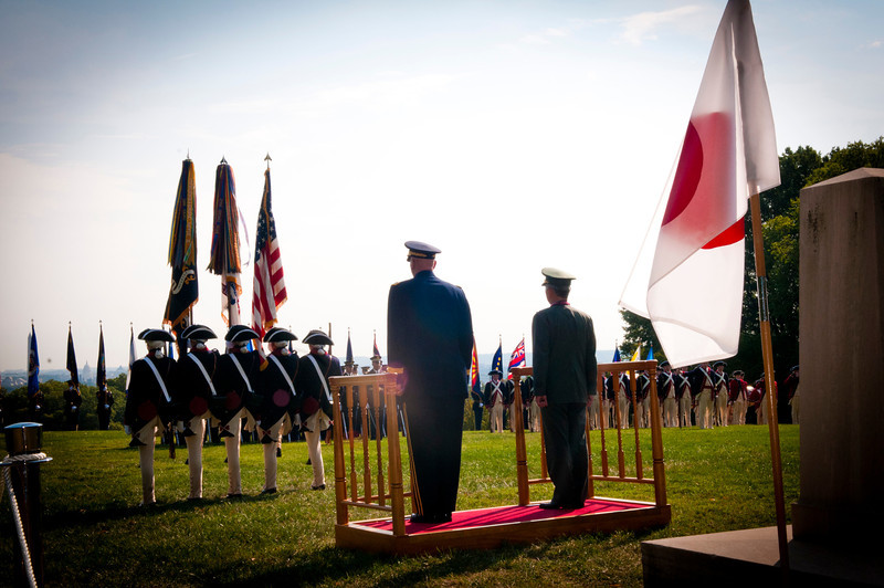 "U.S. Army Chief of Staff Gen. Raymond T. Odierno (left on stage) and Japanese Ground Self-Defense Force Chief of Staff Gen. Eiji Kimizuka (right on stage), observe members of the 3d U.S. Infantry Regiment (The Old Guard) conduct ""march on"" during Kimizuka's award ceremony, Sept. 27, 2012, Joint Base Myer-Henderson Hall, Va.  Gen. Kimizuka received the award for promoting family welfare through the development a Japan Ground Self-Defense Force family support structure. (U.S. Army photo by Staff Sgt. Bernardo Fuller)"