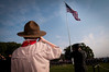 A young Boy Scout salutes the American flag during an award ceremony for Japanese Ground Self-Defense Force Chief of Staff Gen. Eiji Kimizuka, Sept. 27, 2012, at Joint Base Myer-Henderson Hall, Va.  Gen. Kimizuka received the award for promoting family welfare through the development a Japan Ground Self-Defense Force family support structure. (U.S. Army photo by Staff Sgt. Bernardo Fuller)