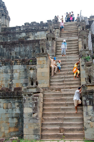Making the perilous descent from a sunset-viewing vantage point. Having scoped out the sole exit, we left way before it got crowded or dark.<br /> <br /> Angkor Wat, Cambodia