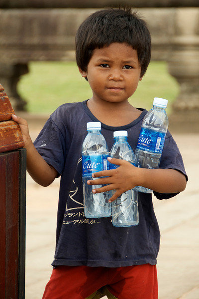 Collecting bottles..<br /> <br /> Angkor Wat, Cambodia
