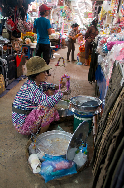 Food vendor at a decidedly non-touristy market.<br /> <br /> Siem Reap, Cambodia