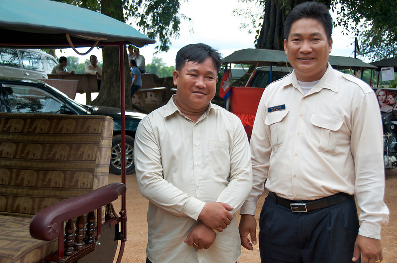 Our TukTuk driver and our guide. A good guide is invaluable in helping make the ruins come alive. Without one, it would be easy to just wander aimlessly around the vast ruins without getting much out of the experience beyond heat stroke.<br /> <br /> Angkor Wat, Cambodia