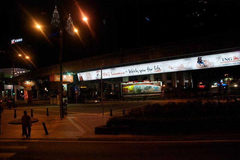The Petronas Towers rise behind the Kuala Lumpur monorail (Peoplemover).<br /> Kuala Lumpur, Malaysia
