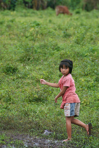 Young girl in the fields outside the village.<br /> <br /> Laiwo, Thailand