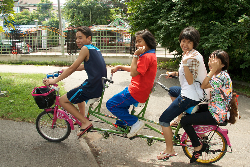 A bicycle built for four. I get the feeling that the guy in front may have been the only one pedaling on their scenic journey around the lake.<br /> <br /> Khon Kaen, Thailand