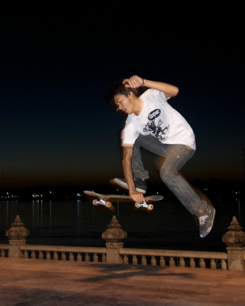 Skateboarding along the Mekong River.<br /> <br /> Nong Khai, Thailand