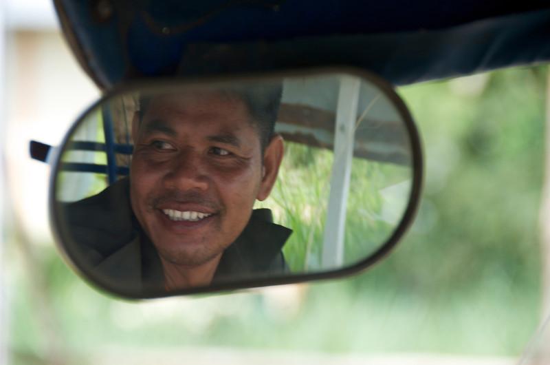 Tuktuk driver taking me from the roadside bus stop to the King Cobra farm.<br /> <br /> Ban Kok Sa-Nga (outside of Khon Kaen), Thailand