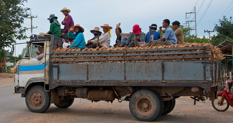 A group of friendly workers wave as I waited by the side of the road for a bus.<br /> <br /> Somewhere outside of Khon Kaen, Thailand