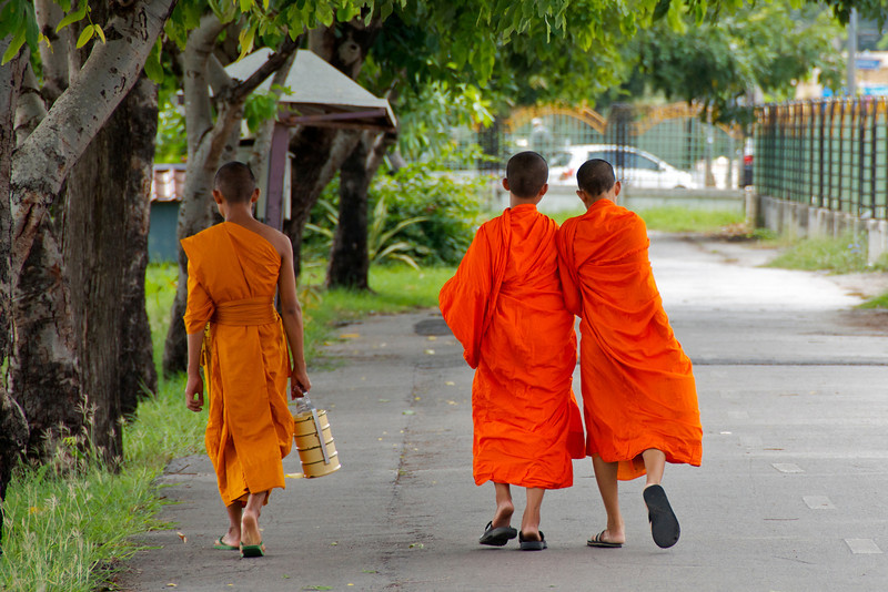 Young monks playing around.<br /> <br /> Khon Kaen, Thailand