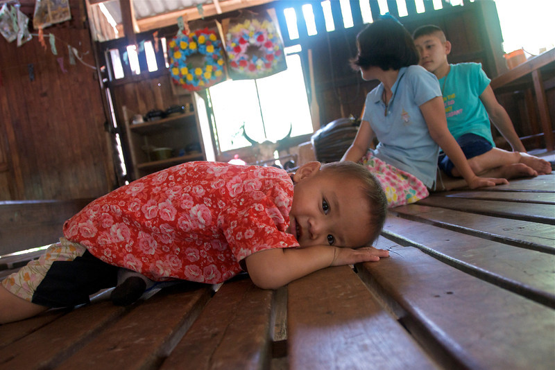 Another village kid, with 2 of my students in the background.<br /> <br /> Laiwo, Thailand