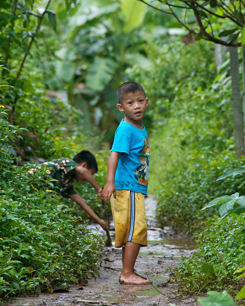 Stopping to play on the walk home.<br /> <br /> Laiwo, Thailand