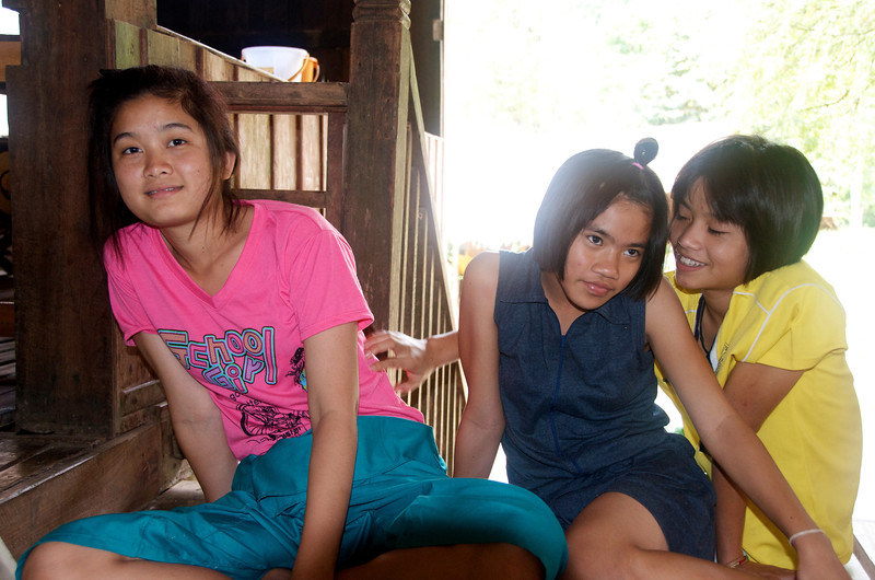 Three of my students at the Wat (temple) before making an offering to the monks.<br /> <br /> Laiwo, Thailand