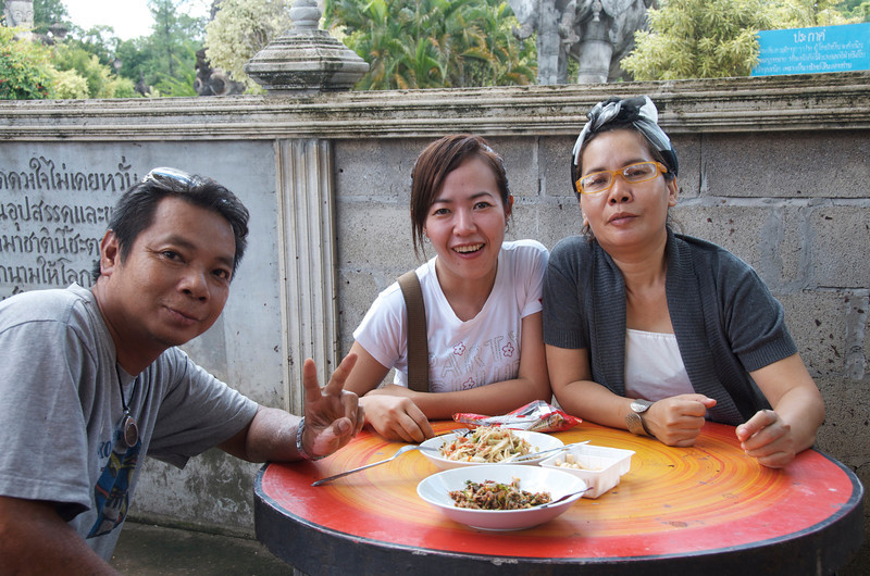 Sharing lunch with new friends just outside of Sala Keoku Sculpture Park. I was warned that the bowl closest to the camera contained a very spicy dish. I tasted it and found that I could handle the heat. It was only later that I realized that it was a raw shrimp dish. <br /> <br /> Nong Khai, Thailand