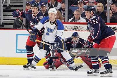 COLUMBUS, OH - JANUARY 11: Rostislav Klesla #97 of the Columbus Blue Jackets and Keith Tkachuk #7 of the St. Louis Blues battle for position in front of the net as goaltender Pascal Leclaire #31 and Adam Foote #52 of the Blue Jackets watch for the puck on January 11, 2008 at Nationwide Arena in Columbus, Ohio.  (Photo by Jamie Sabau/NHLI via Getty Images)