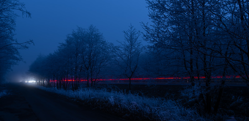 Night winter road - red line
