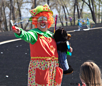 Clown creating soap bubbles at Niwot, CO Easter celebration