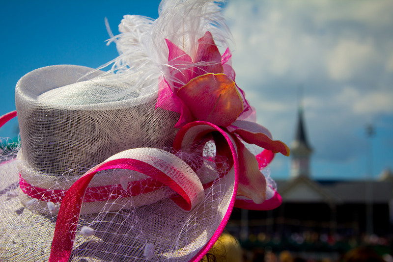 5.6.11 Oaks Day, Churchill Downs, Louisville KY<br /> <br /> I was walking around the infield of Churchill Downs on Oaks Day looking to take photos off Ladies and their hats. I found this lady walking and I saw the Twin Spires in the background. I continued to walk behind her and got the shot I was hoping for.
