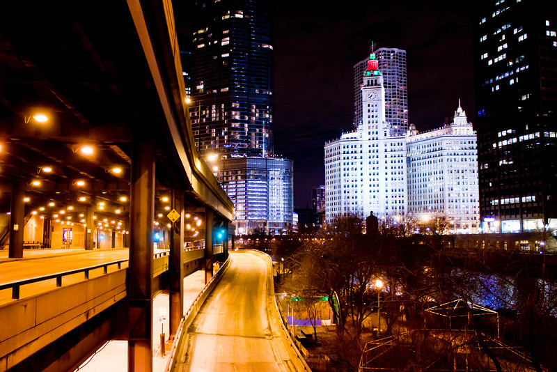 Chicago IL 1.4.12<br /> <br /> I had a few hours to kill that night so I walked around Chicago to see what I could capture. After shooting around Millennium Park I drove over this bridge and saw the river with The Wrigley Building in the background and decided to see what I could shoot. After shooting from the bridge I was walking back to the car and saw this on ramp and captured this shot.