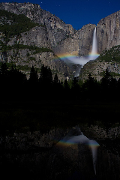 Yosemite Nation Park, 6.14.11<br /> <br /> This is a long exposure shot of Yosemite with a Moonbow. Moonbows can only occur there when they have a clear sky, the moon is high enough, bright enough and there is enough water flowing through the falls to create a high mist. I happen to be there on the perfect night for all. It was clear, a full moon and this year the water is flowing at a higher rate and longer than most the locals I talked to have ever seen. I didn't Photoshop this, the reflection was actually there and so is the moonbow!