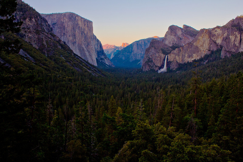 Yosemite National Park - June 2011<br /> <br /> I went back to June for this week's photo of the week. I was working on my new header for my website this week, and came across this photo. It's my version of the famous Ansel Adams photo of the Yosemite Valley. There are a couple differences between our photos. His of course was in black in white, but he also shot it a little tighter and had a cloudy day. I was only there for one day and there was only one cloud in the sky all day, I caught that in one shot, but not in this one. It was nice to stand in almost the same spot as such a pioneer in Landscape Photography. Even though this was a quick day trip for me, it was one of the most memorial days I will ever have. I hope I'm lucky enough to spend many more days in one of the most beautiful places in the world!