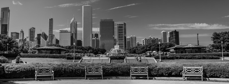 Chicago IL - Benches and Buckingham Fountain with the city as a backdrop.