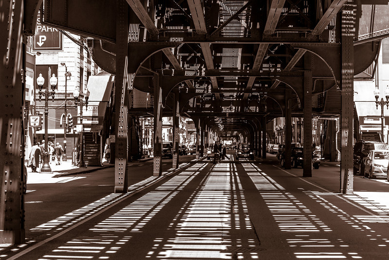 Chicago IL - Under the EL. <br /> <br /> I had been wanting to capture this shot for many years. It just never worked out until this day. It was a clear sunny day, just about noon, so the sun was straight above creating these lines.