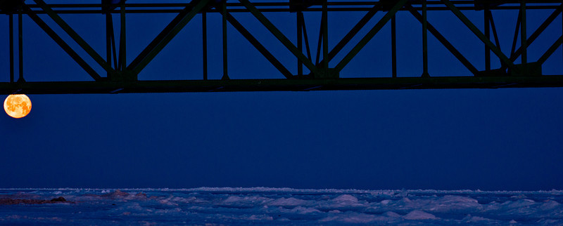 Mackinac Bridge 2.8.12<br /> <br /> As many of you know I have shot thousands of photos of the bridge. This morning I was about to cross the bridge and I saw the moon setting to the west while the sun was rising to the east. I stopped and captured this image and it's one of my favorites so far.