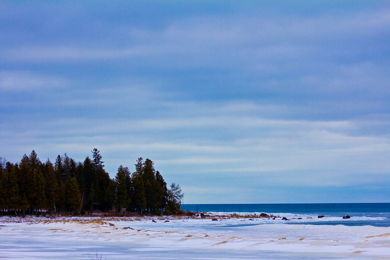 U.P. Michigan Highway 2 - 2.1.12<br /> <br /> I have driven by this location dozens of time and always knew there was a photo opportunity here, I just had to wait for the right weather conditions. On this day I really liked the frozen water and blue cloudy sky combo.