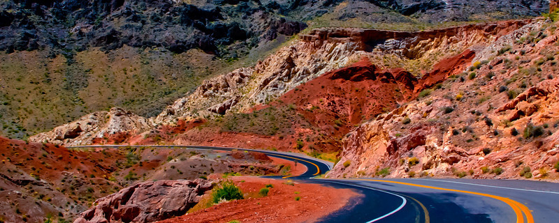 Valley of Fire - Nevada<br /> <br /> I captured this image back in 2010 when I was in Vegas playing in the World Series of Poker. This was the day after I got knocked out of the tournament and I needed to get out of Vegas and get some fresh air. Well I got plenty out here. The Valley is only an hour outside of Vegas and it is absolutely amazing. I saw some colors I had never seen before, and it goes on forever. For this shot I was looking in my review mirror and saw the road I had just traveled. I pulled over and captured this image