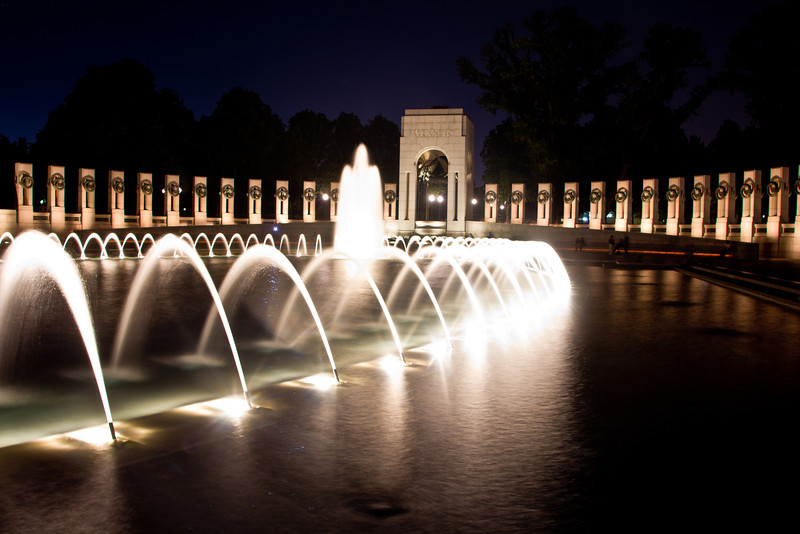 WWII Memorial – Washington D.C. June 6th 2011<br /> <br /> I had a few days to spend in-between working in Cleveland and Syracuse so I decided to drive to D.C. to see a friend and meet his wife and son for the first time. While I was there I went out and did some night shooting. This was the first night, I started at the Washington Monument and then heading here to the WWII Monument. I had 3 grandpas' that served in the war and it's not something I think about much, but while I was standing here taking this photo, I felt a connection with them and a pride of what they had done. What a generation to make so many sacrifices, not only the soldiers but everyone at home. I have been to D.C. many times but this is the first time I had been to this monument, I don't think there will be a time I go back and don't take a moment to stop here and pay my respects.