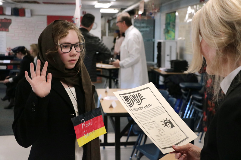 "5th graders became 1918 immigrants for a day on Feb. 9, arriving at Ellis Island and having to convince immigration officials (played by their parents) that they should be allowed to enter the U.S.  See more photos from this innovative learning experience at <a href=""https://saintgeorges.smugmug.com/Academics/LS-5th-Immigrants-2-9-18/"">https://saintgeorges.smugmug.com/Academics/LS-5th-Immigrants-2-9-18/</a>"