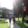 """The air glowed with sunlight on a cool September morning. View more photos of students headed into school just before the start of autumn at <a href=""""https://saintgeorges.smugmug.com/Community/Bus-Stop-in-Morning-Sunlight-9-19-18/"""">https://saintgeorges.smugmug.com/Community/Bus-Stop-in-Morning-Sunlight-9-19-18/</a>."""