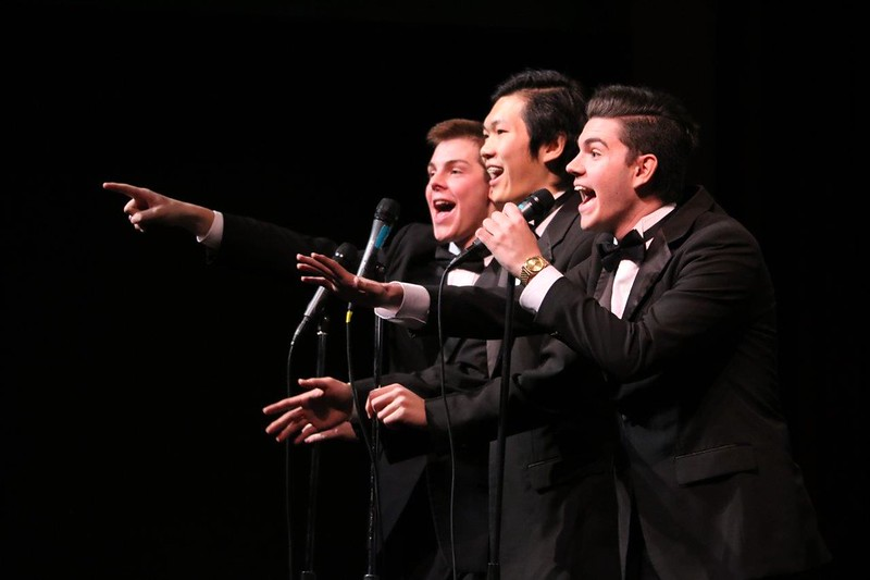 Hunter Hyde, Mickey Zhang and Truman Harris make a point during a song by the Upper School Jazz Choir at the Holiday Concert on Dec. 7.