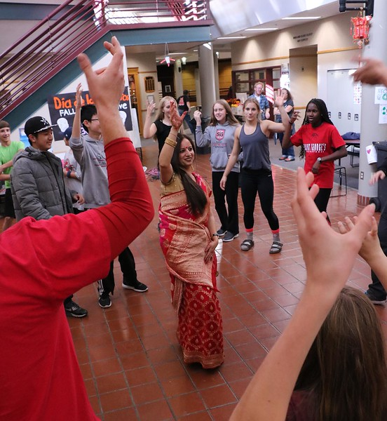 SGS parent Sakshi Choudhary led students in traditional Indian dances in the Upper School Courtyard as part of International Culture Day on Oct. 19.