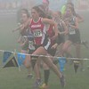 Almost lost in the fog, defending champion Madison Ward charges at the start of the State Cross Country 1B/2B race on Saturday, Nov. 5 in Pasco.  Madison finished 2nd overall this year.
